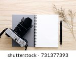 blank notebook and vintage... | Shutterstock . vector #731377393