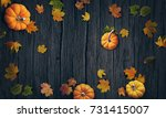 pumpkins and autumn leaves top... | Shutterstock . vector #731415007