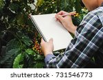 close up farmer take notes with ... | Shutterstock . vector #731546773