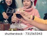 group of friends celebrating... | Shutterstock . vector #731565343