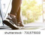 young woman execute exercise in ... | Shutterstock . vector #731575033