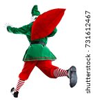 xmas time and green elf  | Shutterstock . vector #731612467