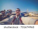 handsome smiling man tourist... | Shutterstock . vector #731674963