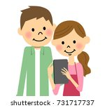 the couple who operates a tablet | Shutterstock .eps vector #731717737