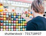 young man aims at wall of... | Shutterstock . vector #731718937