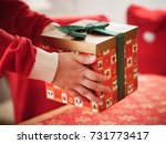 preparing a christmas gift box   Shutterstock . vector #731773417