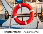 red lifebuoy  fixed on deck of... | Shutterstock . vector #731848393