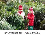 family selecting christmas tree.... | Shutterstock . vector #731859163