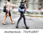 people shopping in the city in... | Shutterstock . vector #731912857