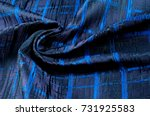 Small photo of Texture, fabric, background. Woolen cloth. Dark blue stripes. Black Stripes