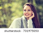 beautiful woman outdoors in... | Shutterstock . vector #731975053