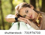 young  girl smiling in autumn...   Shutterstock . vector #731976733