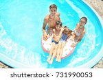 happy family with inflatable... | Shutterstock . vector #731990053