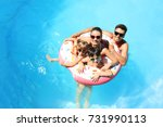 happy family with inflatable... | Shutterstock . vector #731990113
