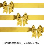 identical golden bows on a... | Shutterstock . vector #732033757