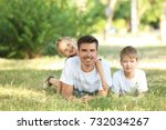 father with children in park on ... | Shutterstock . vector #732034267