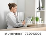 young female receptionist... | Shutterstock . vector #732043003