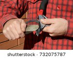 Small photo of Sharpen Pruning Shears For The Perfect Cut. Cleaning and Sharpening Garden Tools.