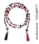 Small photo of Luxurious beautiful red abd black necklace made of metal chains, threads and crystals on a white background