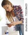 woman connecting smartphone... | Shutterstock . vector #732218623