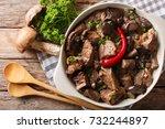beef stew with wild mushrooms ... | Shutterstock . vector #732244897