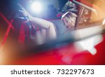 sensual girl at the wheel of a... | Shutterstock . vector #732297673