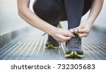 sports in a city   woman tying... | Shutterstock . vector #732305683