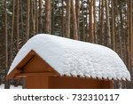 big snowdrift on the roof after ... | Shutterstock . vector #732310117
