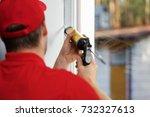 worker applying caulk around... | Shutterstock . vector #732327613