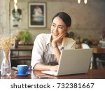 asian woman working in coffee... | Shutterstock . vector #732381667