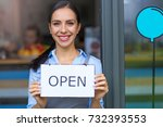 woman holding open sign in cafe  | Shutterstock . vector #732393553