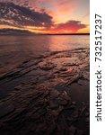 a dramatic sunrise over lake... | Shutterstock . vector #732517237