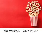 Paper Cup With Popcorn On Colo...