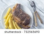 beef steak with fried potatoes... | Shutterstock . vector #732565693