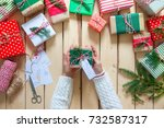 on a wooden background presents ... | Shutterstock . vector #732587317