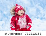 baby playing with snow in... | Shutterstock . vector #732613153