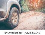 car wheel on a dirt road. off... | Shutterstock . vector #732656143