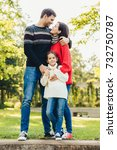 young happy family of three... | Shutterstock . vector #732750787
