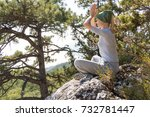 woman meditating in mountains...   Shutterstock . vector #732781447