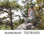 woman meditating in mountains...   Shutterstock . vector #732781453