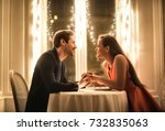 sweet couple having a romantic... | Shutterstock . vector #732835063