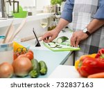 man cooking in the kitchen and... | Shutterstock . vector #732837163