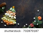 christmas tree from a salad... | Shutterstock . vector #732870187