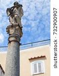 Small photo of Ancient stature on stone column, old town of Lacco Ameno. Ischia, Italian island in the Tyrrhenian Sea