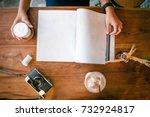 top of hand holding cup of hot... | Shutterstock . vector #732924817