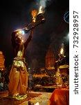 Small photo of Varanasi, India - February 06, 2014: Hindu priest, indian man, brahman, during night religious hindu Ganga Aarti ceremony for Mother Ganges, river and goddess, at Dashashwamedh Ghat, Varanasi