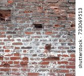 Small photo of Cracked Dark Red Old Brick Wall Texture. Damaged Brown Abstract Blank Stonewall Background. Ruinous Stonewall Dilapidation. Frame Square Dersign Element