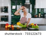 the young tired woman in apron... | Shutterstock . vector #733122673