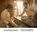 in a traditional bakery  bakers ... | Shutterstock . vector #733136893