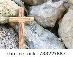 wooden cross between stones | Shutterstock . vector #733229887